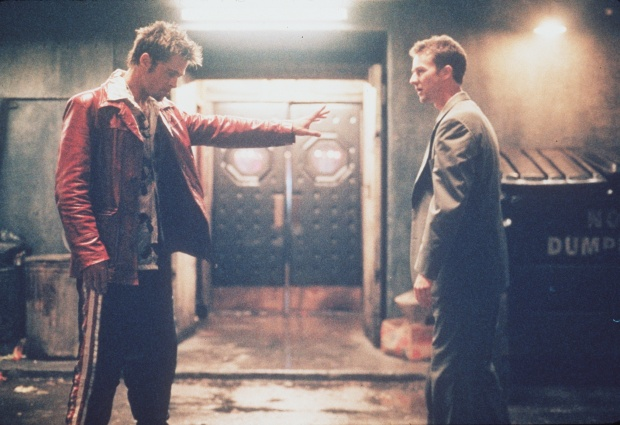 "ET.Fight.1013.MM.10.C––Brad Pitt (left), Edward Norton (right), and Helena Bonham Carter star in ""Fight Club,"" a provocative and unsettling tale of a man named Tyler who sets up fight clubs in which young men are paired off in bloody no–holds–barred bouts until one drops."